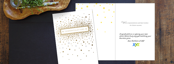 Silver, gold and white come together in a warm but elegant Hallmark congrats card for business, personalized for customers.