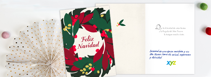 A festive wreath and red-lettered Feliz Navidad message on this Spanish holiday card showcase the Hallmark designs available.