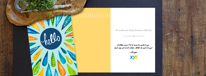 Bright splashes of color against a friendly blue on this Hallmark card are ideal for connecting with clients and customers.