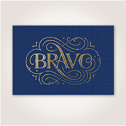 Textured foil lettering and filigree mimics gold leafing in this elegant Bravo greeting card.