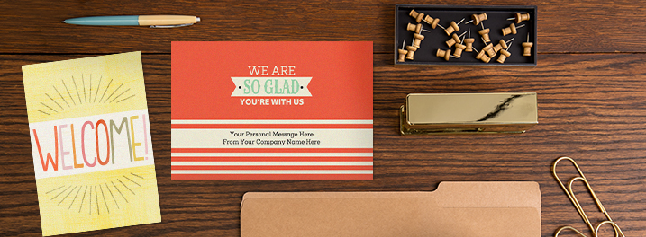 A tangerine and teal cover you can personalize or sunny hand lettered welcome will make new employees feel right at home.