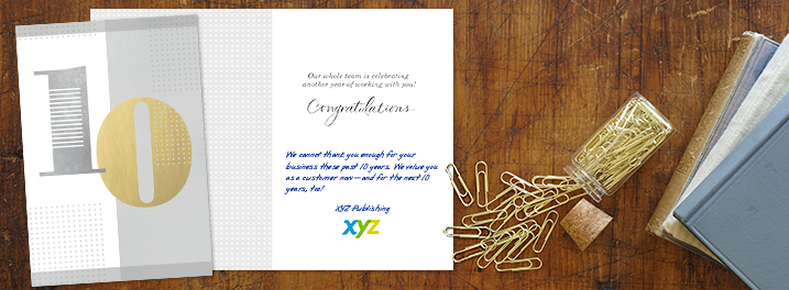 A Hallmark metallic silver and gold 10 year anniversary card to celebrate customer work anniversaries, company anniversaries and years of service.