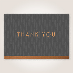 Shining copper foil highlights Thank You on the cover, laid over a muted gray feather pattern.