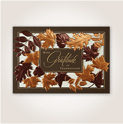 Laser die-cut leaves Thanksgiving card for customers.