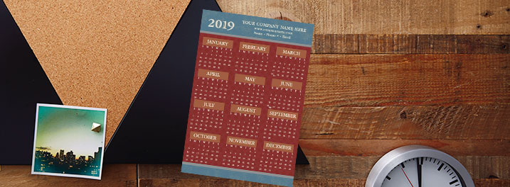 Brick red on slate blue in this 2019 magnetic calendar provides a professional background for your company information.