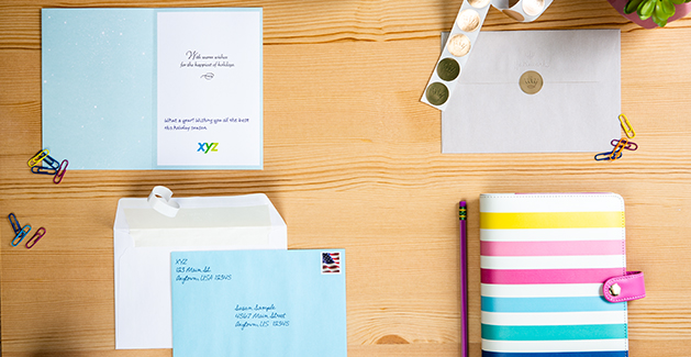 Personalize business holiday cards with Hallmark.