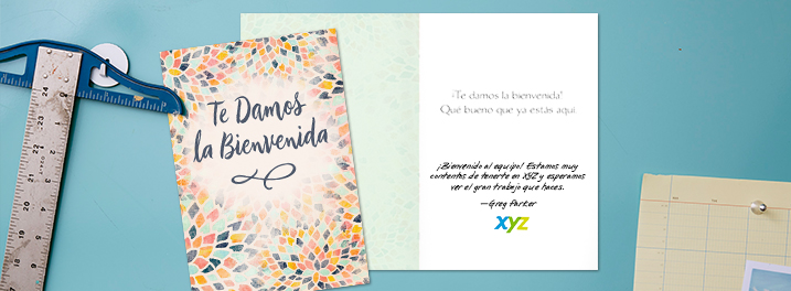 Vibrant and energetic, a colorful mosaic creates the background to this Spanish welcome card for employees.