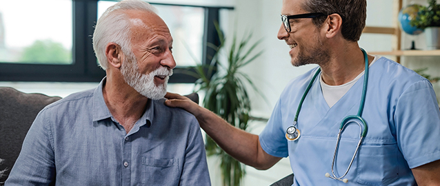 A doctor talks to his patient during a visit—connecting through a card would be an unexpected and meaningful moment.